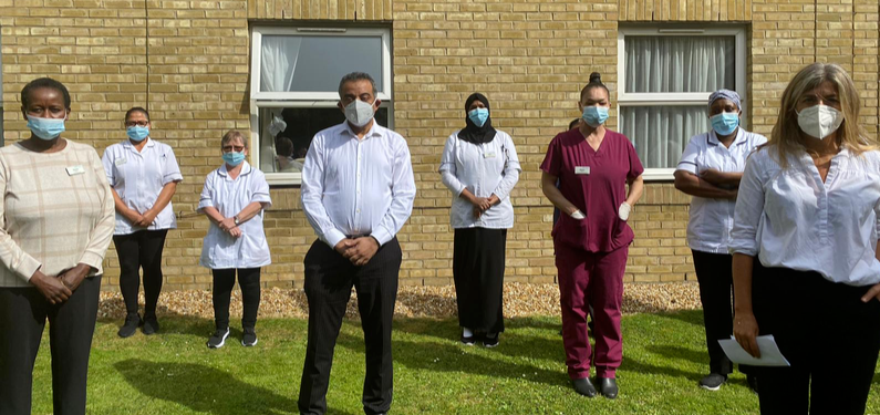 Socially distanced protest with healthcare workers wearing masks