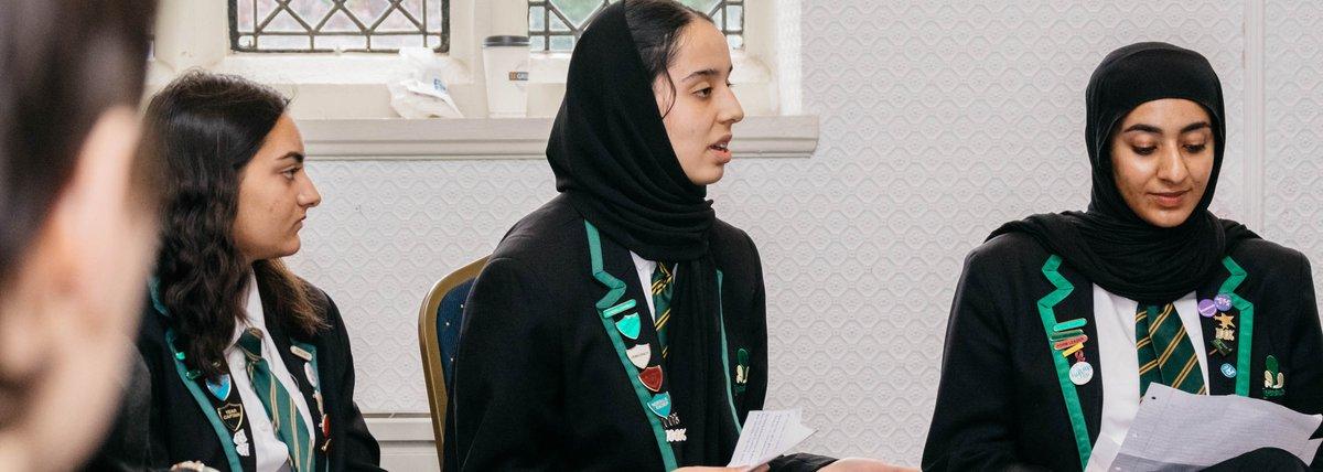 School girls speaking in academic report meeting