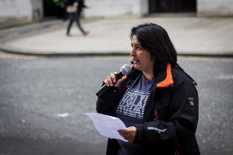 Woman speaking in outdoor public action