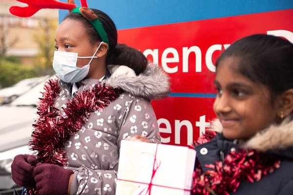 St Mary's students handing in christmas card to lewisham hospital