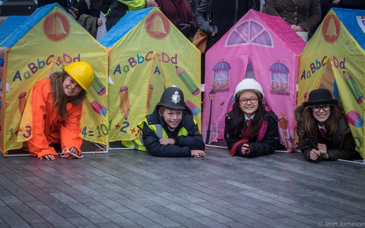 Children smiling outside tents