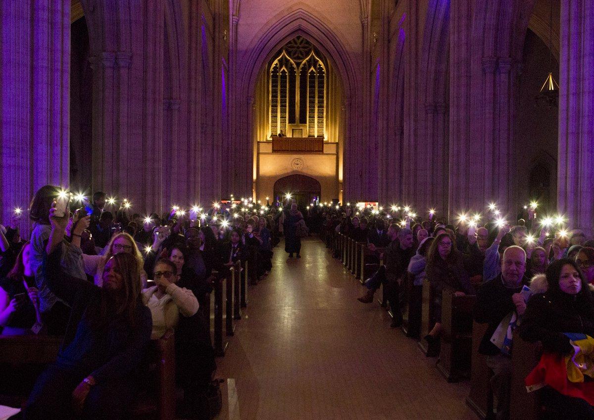 Phone lit faith group gathering