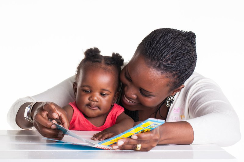 parent and baby reading