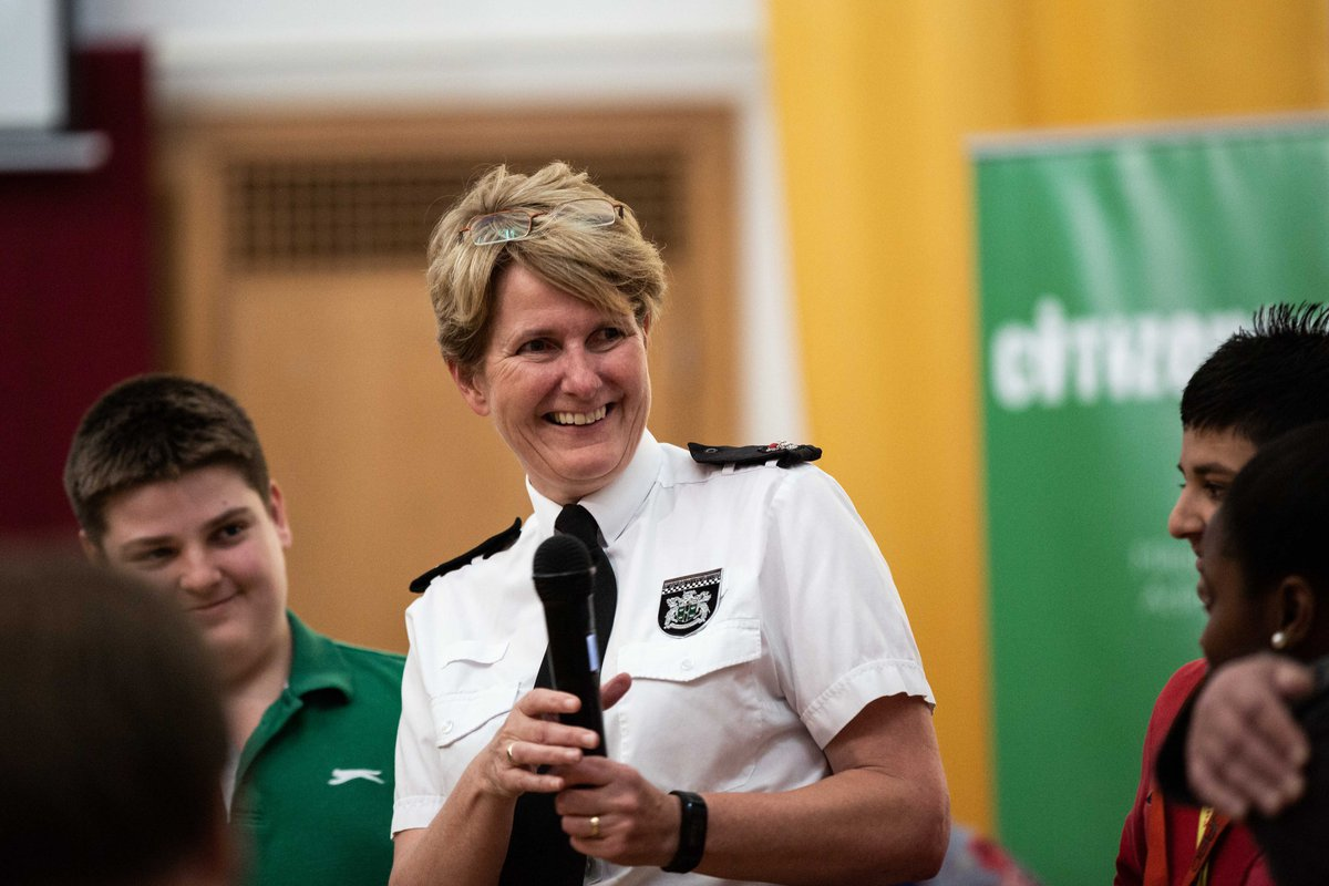 Female police representative smiling during speech